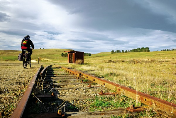 A lone cyclist passing the remains of the rail track and the gangers' shed near Kokonga is but one of the 11,000 bicycle-touring enthusiasts attracted to Central Otago each year by the old rail line turned cycleway.