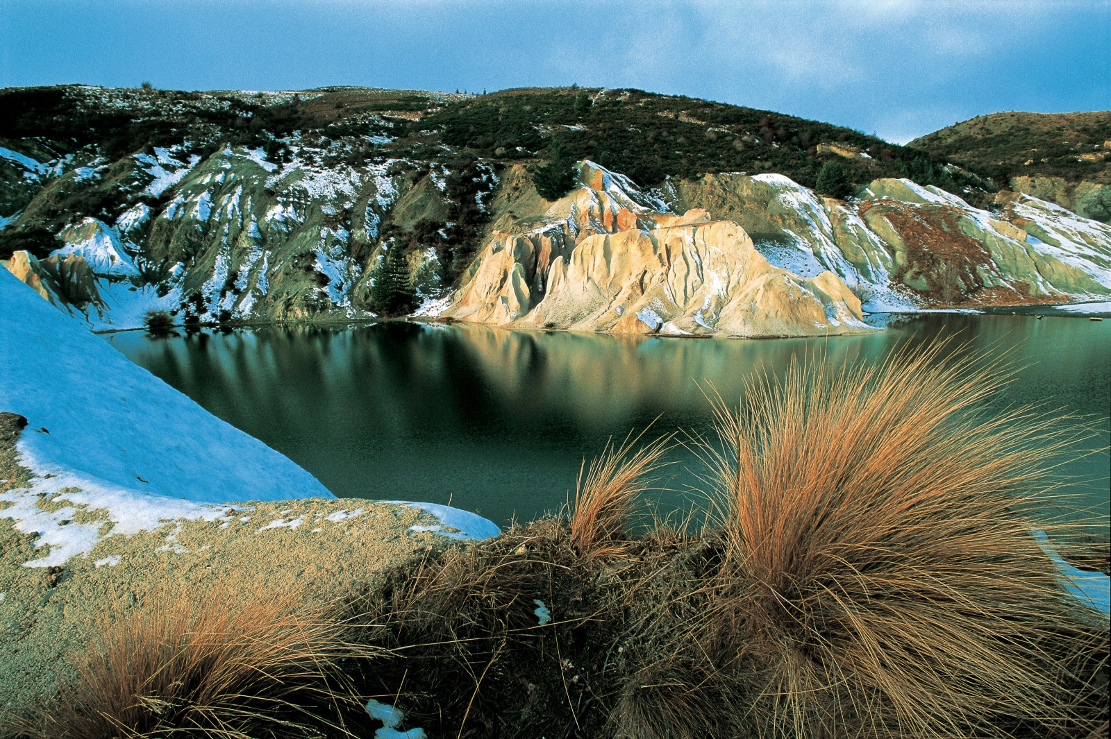 Once a 120-metre-high hill, the 68-metre-deep Blue Lake in St. Bathans was created by a gold sluicing operation which began in 1873. By 1932, the work stopped amid fears that the town's foundations were being undermined. Natural drainage filled the workings creating St. Bathans' signature attraction.