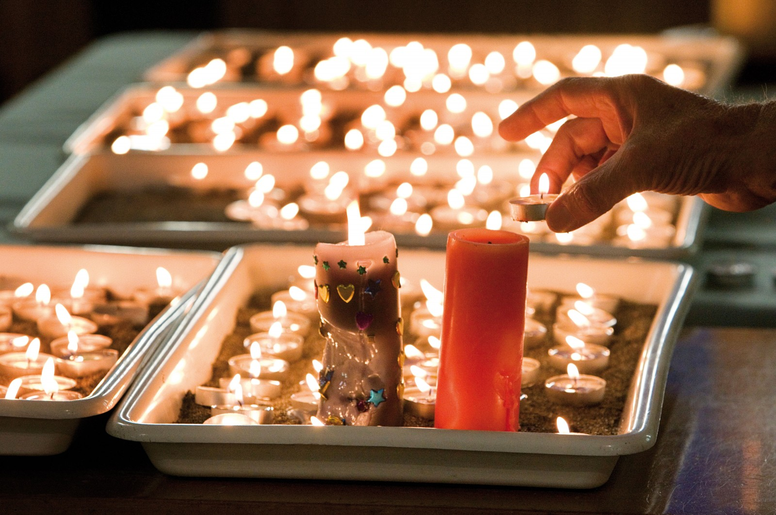 Mourners light candles at a special service at the Holy Trinity Anglican Church in Greymouth following the news of a second explosion in the Pike River mine on November 24.