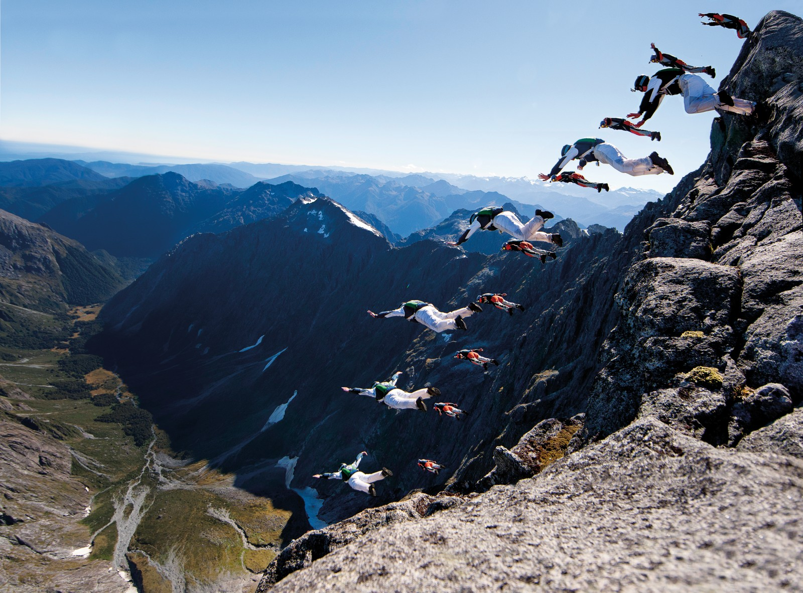 Ted Rudd (foreground) and Alex Polli show their form, leaping in unison from the country's highest wall. The correct body position—plus or minus just three degrees—allows them to 'track' away from the wall into clear air, then glide at close to 200 km/h around escarpments and through ravines, deploying their canopies kilometres farther down Sinbad Gully.