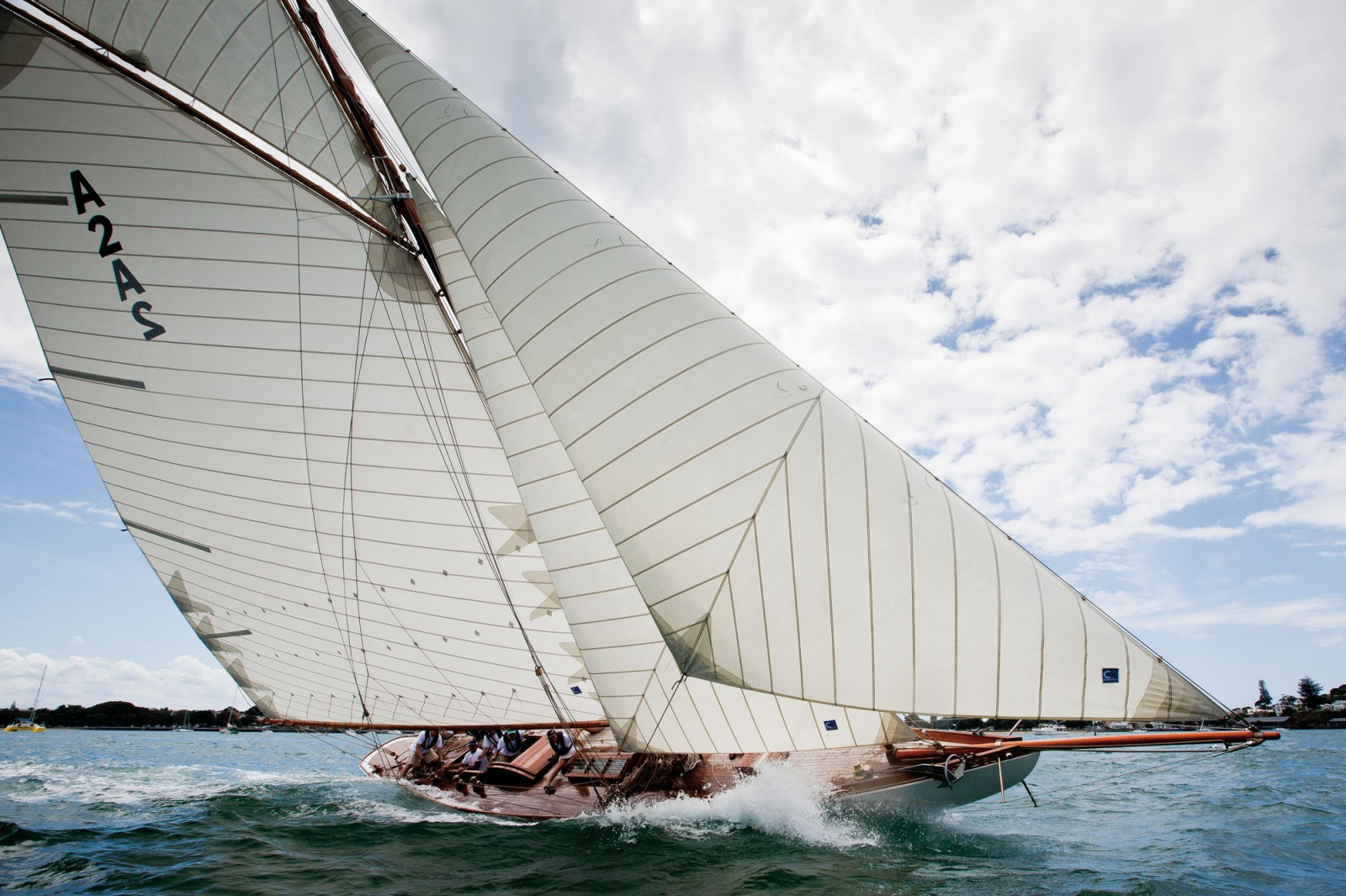 One of the most magnificent of the New Zealand restorations of classic yachts has been of the racing cutter Rawhiti, built in Auckland by Logan Bros for A.T. Pittar of Sydney in October 1905. She sailed the Tasman under jury rig shortly after and became the crack yacht of Sydney Harbour, a place she maintained until the 1930s. In 1946, Auckland yachtsman Hec Marler bought Rawhiti and sailed her back to Auckland. For many years afterwards, converted to a Bermudan cutter, she was one of the best of Auckland's first class yachts, but suffered over the years from alterations and 'modernising'. Ten years ago, she was rescued by a consortium headed by lawyer Greg Lee, which commissioned Peter Brookes of Kumeu to carry out a faithful restoration to her original gaff cutter configuration as befitted her thoroughbred Logan provenance and her brilliant racing history. There have been several landmark restorations of Logan yachts in recent years, but the September 2011 re-launch of Rawhiti used up all the superlatives and attracted much overseas attention. The cost was staggering—well into seven figures, it is believed. While the 2012 regatta was Rawhiti's first for many years, the quality of her kauri timbers and craftsmanship will ensure her at least another century of regattas.