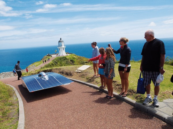 Visitors to Cape Reinga on December 21 looked on as SolarFern travelled the last 100 m of the historic 2146-km, 11-day solar-powered journey from Bluff. Team member Easwaran Krishnaswamy walks ahead to clear the way to New Zealand's iconic northernmost lighthouse.