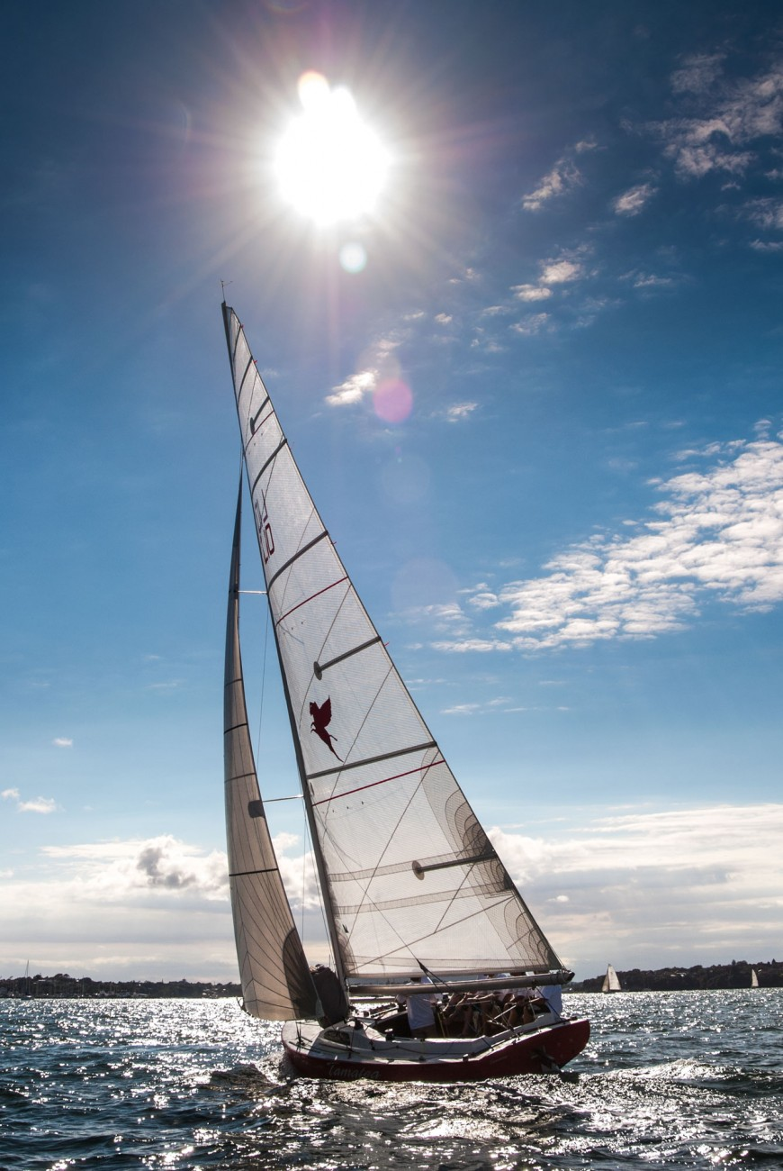 High-tech Mylar sail cloths are now employed on the leading mullet boats—Orion II (above), Tamatea—replacing canvas, Terylene and even Dacron fabrics. In the classic period, spinnakers were cut flat for leading and had to be sheeted to weather of the forestay, an extraordinarily dangerous set up which led to many sinkings and some deaths. Modern double-luffed spinnakers and asymmetrical gennakers still prove a handful in a breeze, and more than half of the fleet racing today has been to the bottom of the harbour at some time.