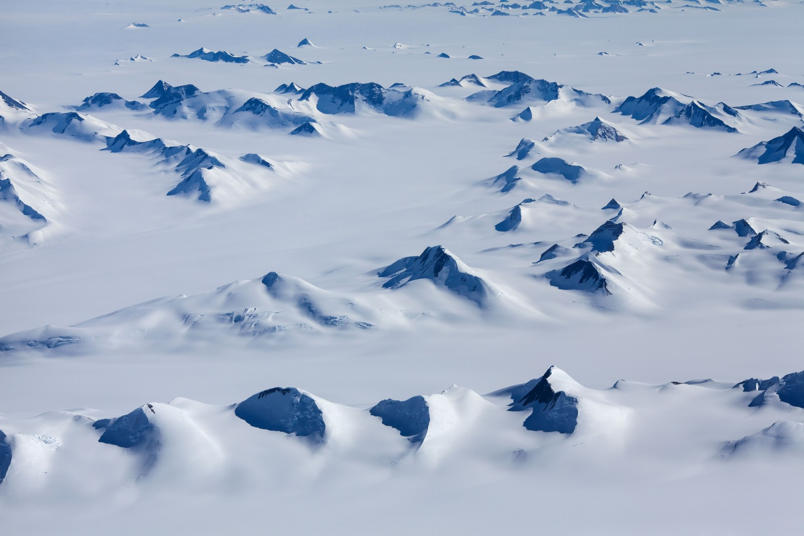 Peaks of the Transantarctic Range protrude like broken teeth from the polar ice cap in Victorialand. The range, which bisects the continent, divides the East Antarctic Ice Sheet from its troublesome twin, the West Antarctic Ice Sheet, which feeds a multitude of glaciers flowing into the Ross and Amundsen Seas.