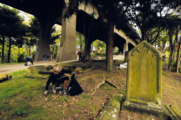 "Volunteers from K' Road's City Presbyterian Church give up their Saturday to collect litter under the Grafton Bridge section of the Symonds Street cemetery grounds. The 'City Pres' church, located in Samoan Fale House halfway along K' Road, believes that its ministry is to ""love God, love others, love the city""."