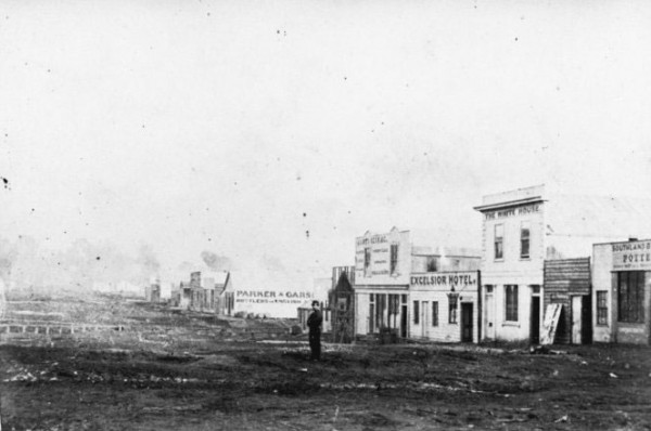 Hokitika's main street was a muddy thoroughfare in 1867 when this photograph was taken, probably by the Tait brothers. The port had recently opened and the hotels that had sprung up—among them The White House and Excelsior, pictured—were evidence of rapid growth in both trade and success on the goldfield. However infrastructure remained rudimentary, and sanitation deplorable.