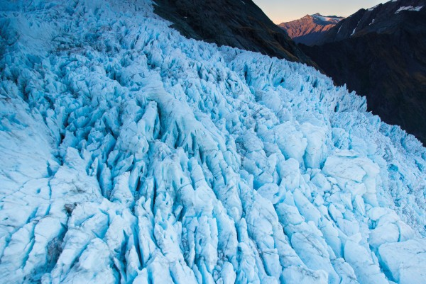 The Bonar Icefall tumbles in slow motion down the western flank of Mt Aspiring, clasping water that may have fallen on the mountain's upper ramparts more than 50 years ago. When it finally melts at lower elevation it will run to sea down the Bignell Stream.