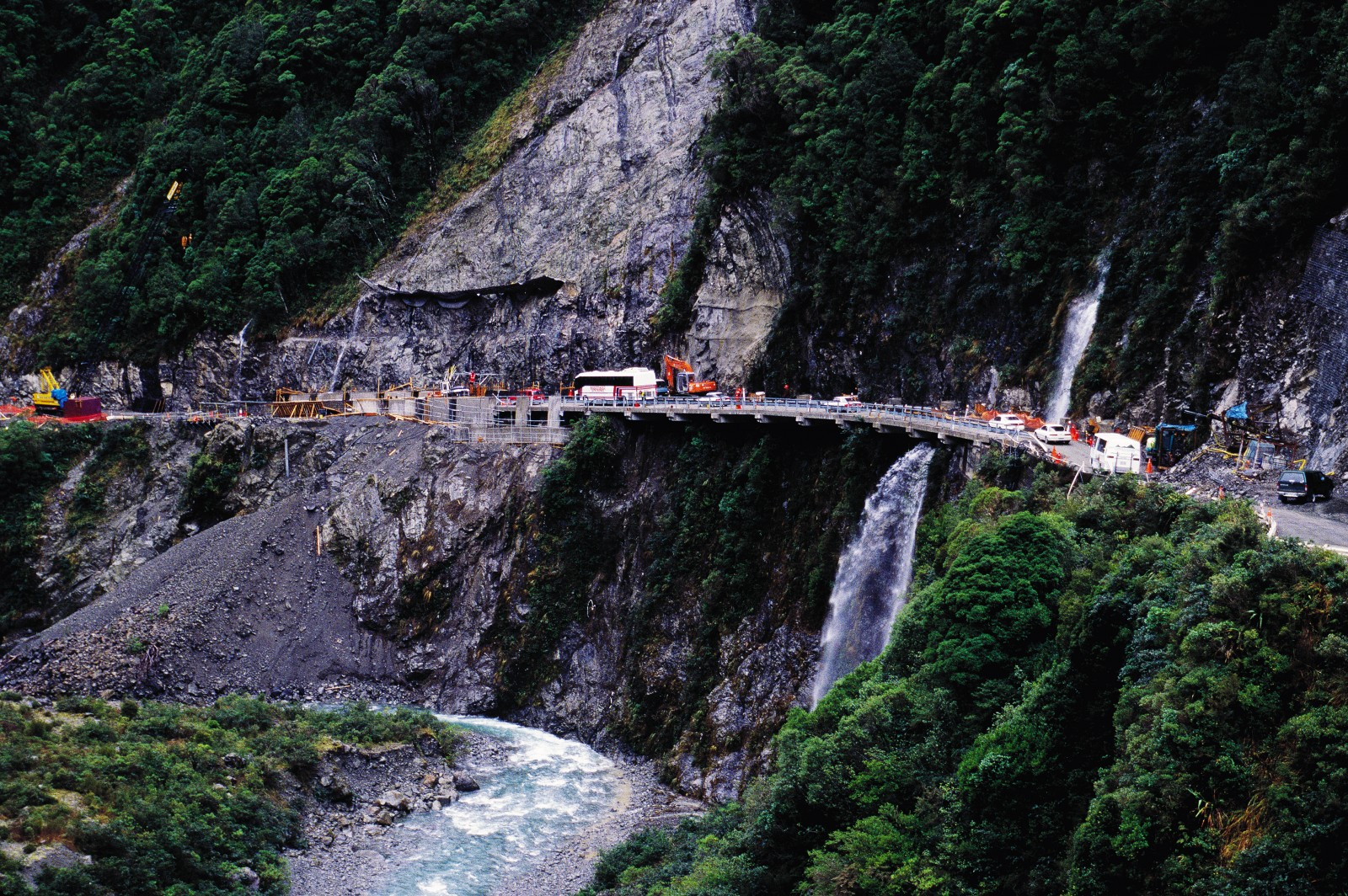Transit New Zealand recently spent $39 million on improving the road between Arthur's Pass and Otira, building a 440 m viaduct and a new bridge and upgrading a particularly treacherous 900 m of road between Candy's Bend and Starvation Point-shown here. In this area, the road was little more than a narrow ledge cut into the mountainside, regularly raked by rockfalls. New Cantilevers have widened the road, and a concrete roof-completed since this photograph was taken-protects the most vulnerable section from tumbling boulder.