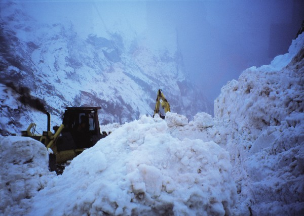 Cold temperatures, steep mountains and an annual rainfall of the order of seven metres are an ideal recipe for avalanches, a greater hazard on the Milford road than on any other in the country. Heavy machinery is needed to clear avalanche debris in an effort to keep the road open.