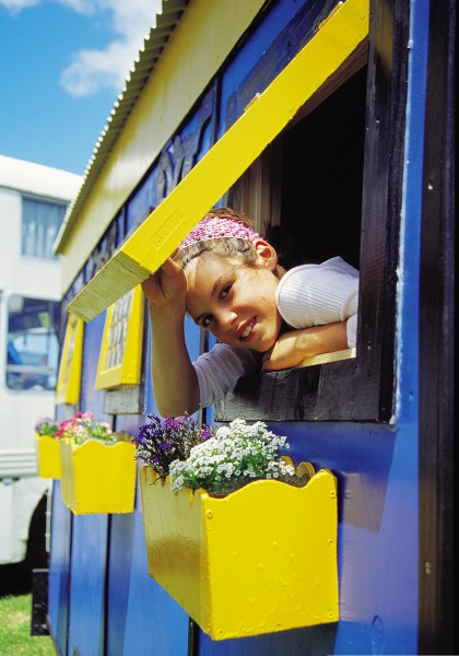 """Like any 11-year-old, Letitia Scott loves having her own room—even if it is just one third of a partitioned trailer. """"It's my own space,"""" says Letitia, who has been a gypsy girl since the age of six. With two sisters and many other children to mix with, she doesn't lack for company while the fair is on tour. Harder to find in such a social environment, and in the confines of a mobile home, is a little privacy."""