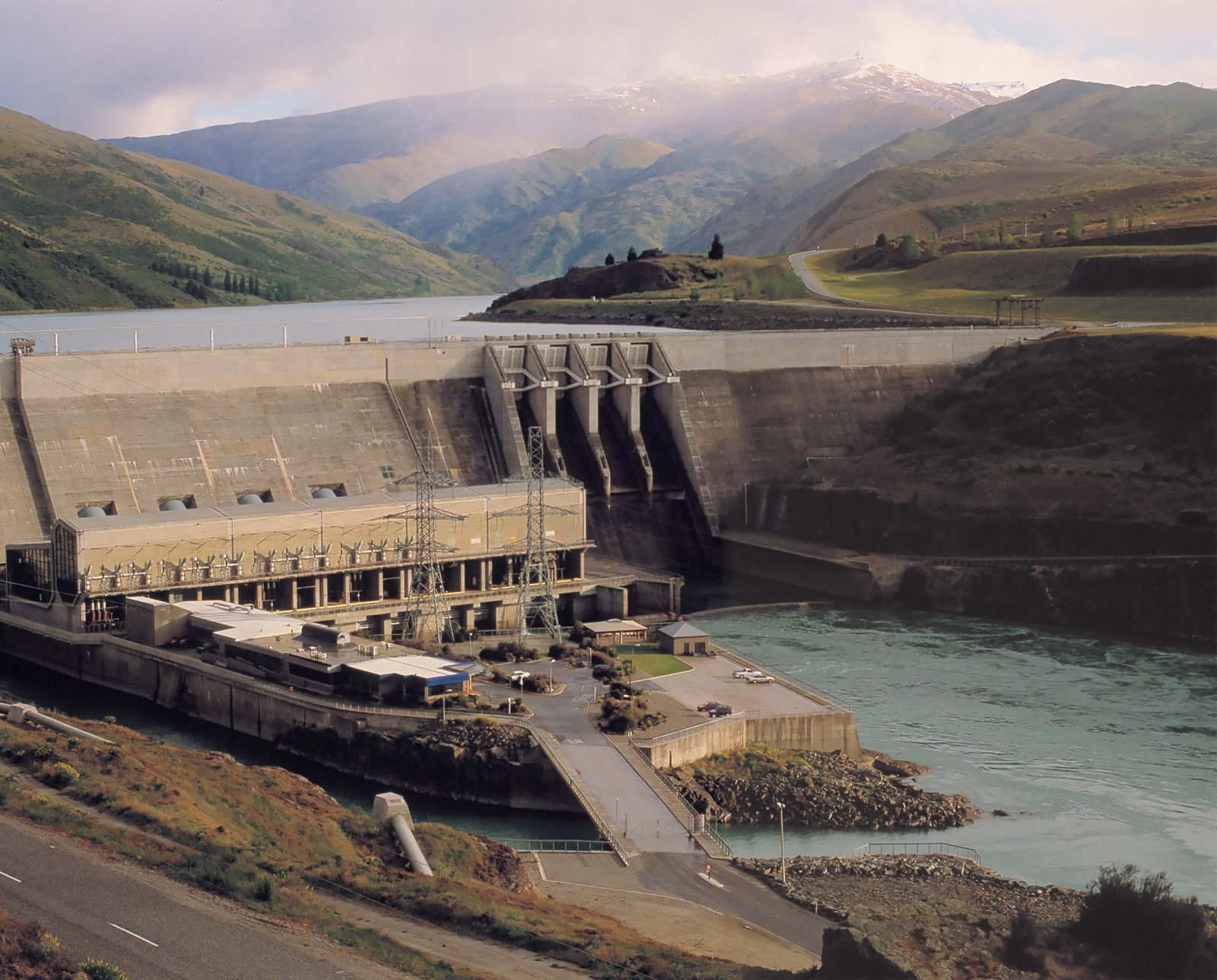 The Clyde dam, the largest concrete dam in New Zealand, is 100 m high, 490 m long, contains one million cubic metres of concrete and can produce 432 megawatts of electricity. Controversial from its inception—much of the town of Cromwell had to be rebuilt or relocated as the dam's lake filled, and there were concerns about land stability and cost overruns—the project was completed in 1993.