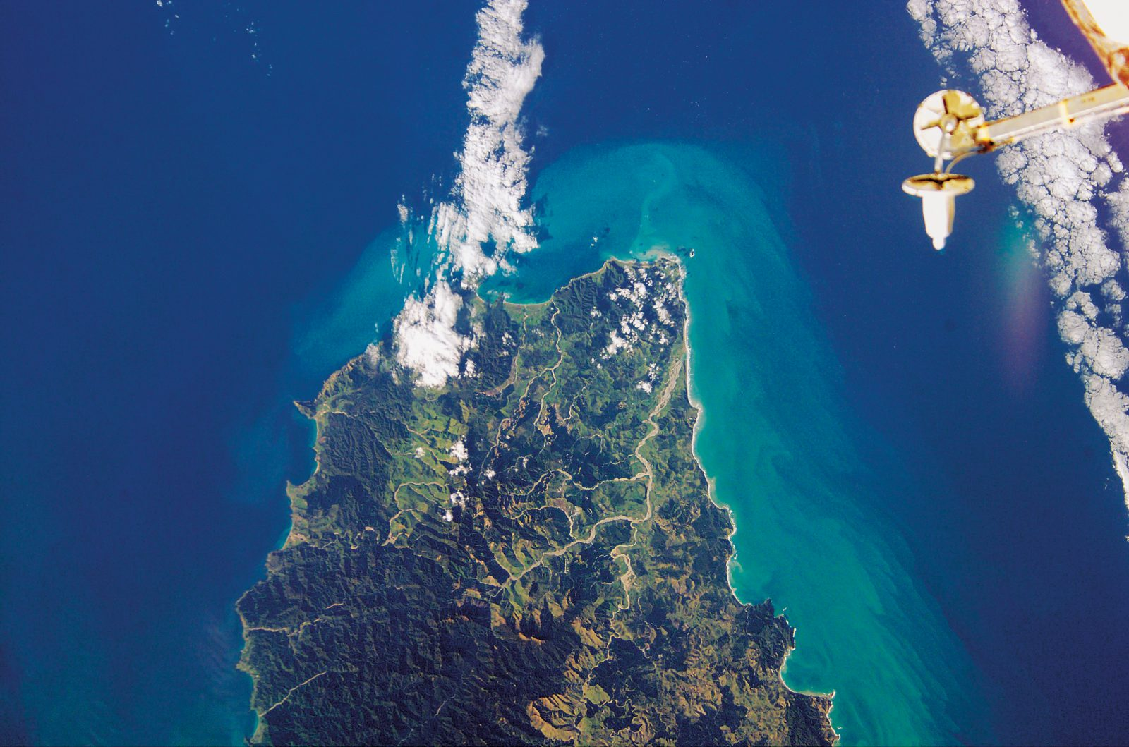 While the Waiapu River system is prominent in this photograph of East Cape taken from the International Space Station in November 2002, Mt Hikurangi, the highest summit in the Raukumara Range, is not at all obvious