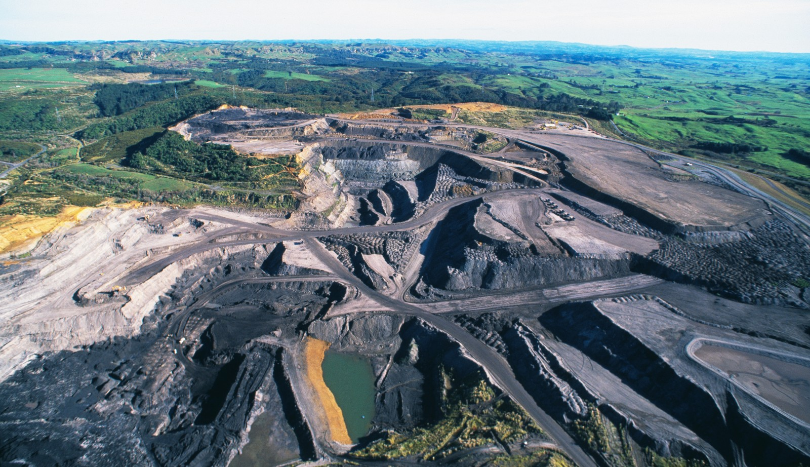 The North Island's largest mine, Rotowaro opencast, a few kilometres west of Huntly, started production in 1997 and has another eight or so years of operational life left. Around a third of Rotowaro's annual output of 1.3 million tonnes of sub-bituminous coal is used in steelmaking, while most of the rest is burned to generate electricity in Huntly Power Station.