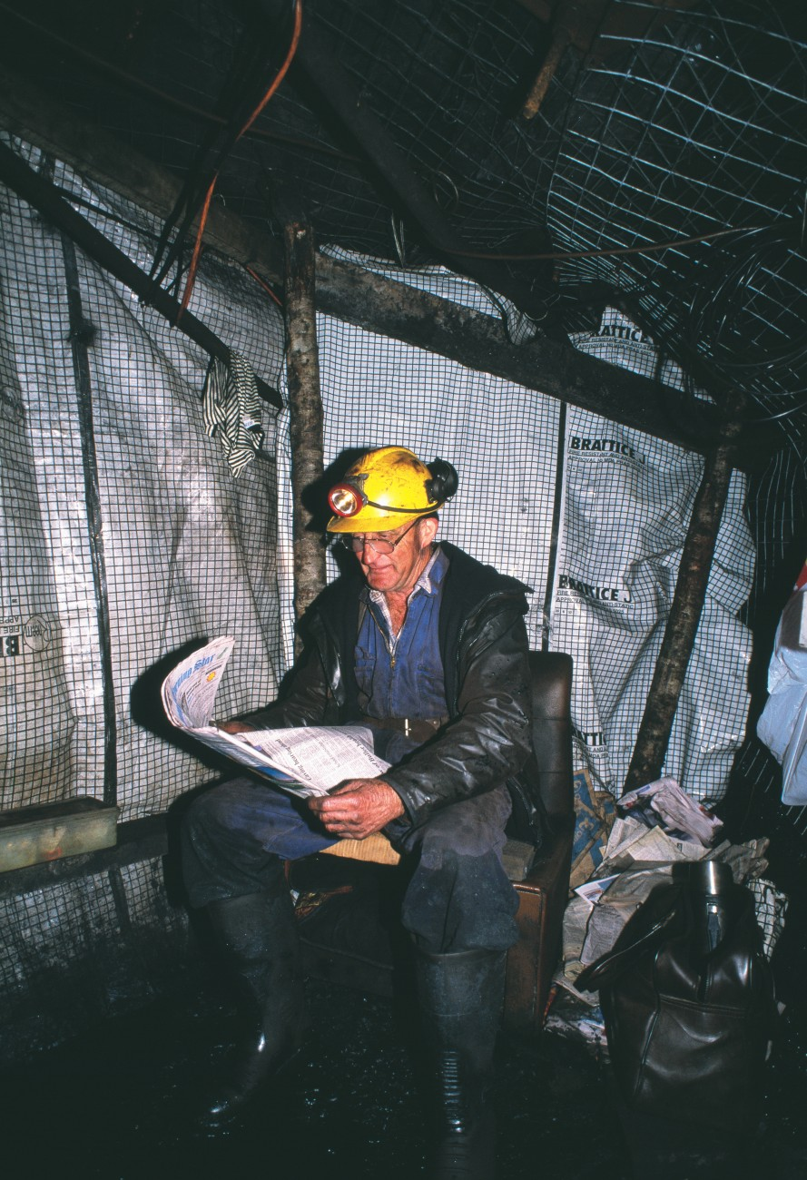 Hap Hepburn takes time out from manning the water pumps in Roa mine to catch up with what's been happening above ground. In many mines, water is used to carry out coal.