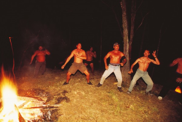 By night the forest takes on a different air as male students perform a haka around the fire.