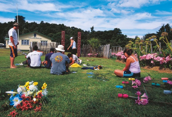 To prepare for the feast on the final night, students make gifts and decorations from the flowers that grow around the marae.