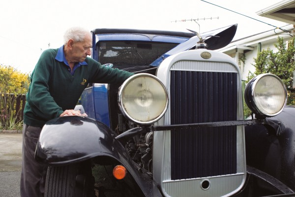 Long-time resident Cyril Thomas (here with a 1928 Oldsmobile he completely restored) sees houses he built decades ago for $10,00 now selling for thirty times that figure.