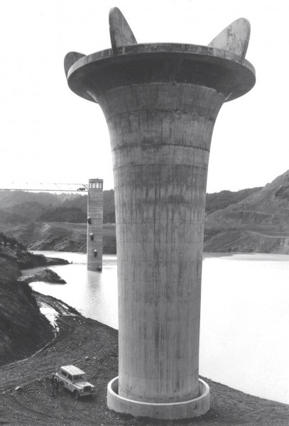 the 67.2 m high bellmouth spillway shaft is exposed at Mangatangi as the waters rise for the first time c. 1976-7.