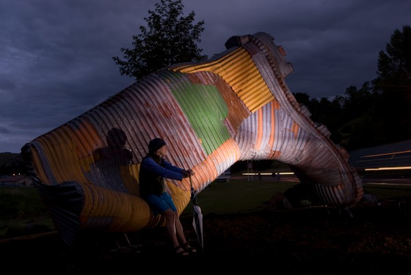 """While other towns erect large objects that emphasise local uniqueness—a carrot in Ohakune, an L&P bottle in Paeroa—Taihape has proclaimed itself """"gumboot capital of the country"""" and commissioned a magnificent corrugated iron civic gumboot from sculptor Jeff Thompson."""