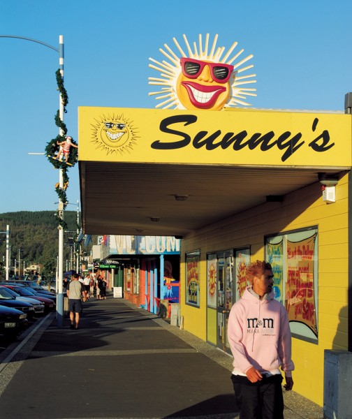 The sunny optimism along Whangamata's main street is augmented at Christmas by Santas on surfboards attached to lamp posts.