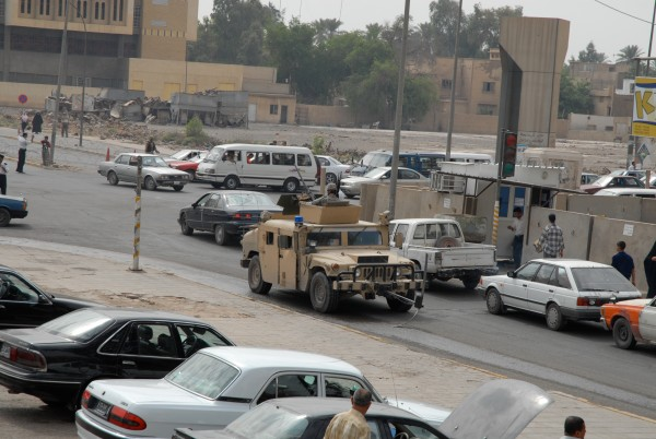 Anyone can buy a police or army uniform and set up a trap that could spell death to a security contractor and his team. A US Army Humvee moves through an intersection as part of a patrol near the strictly controlled International Zone.