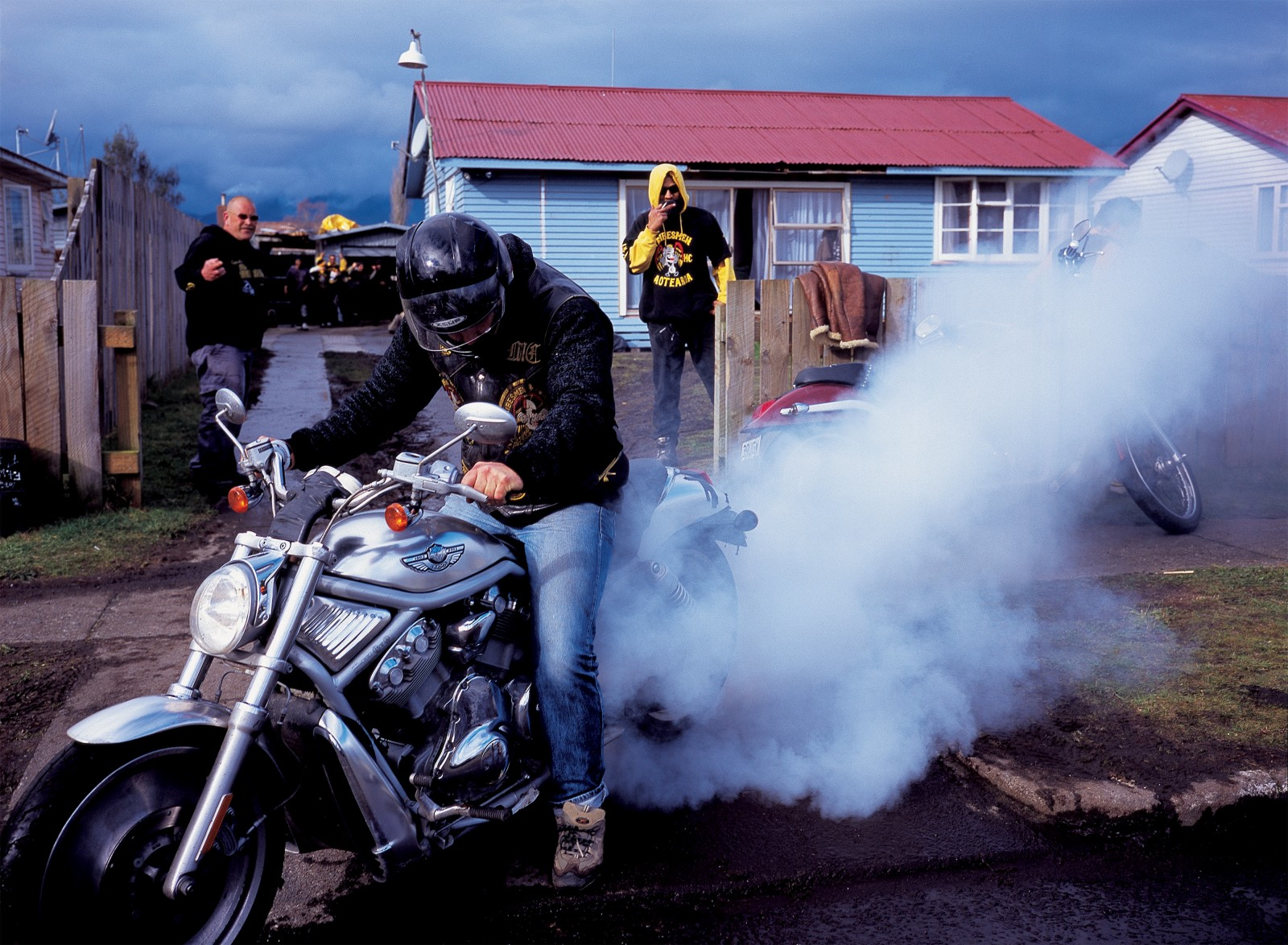 "A burnout ""rider"" performs at the opening of a new Tribesmen pad. He said the speedometer hit 220 km/h—before the tyre blew."