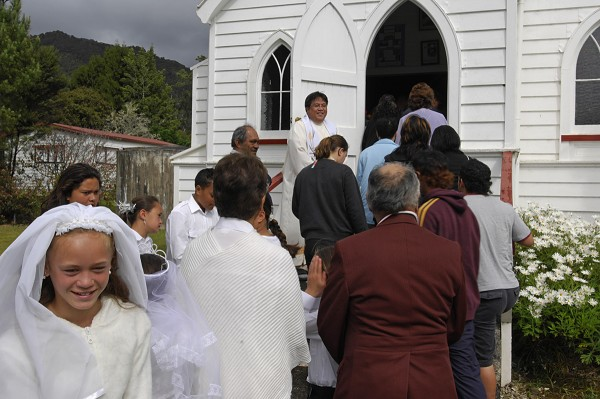 Priest Ricardo Bugas welcomes family members from all corners of New Zealand, even Australia, for first communion and confirmation at the Catholic church in Panguru.