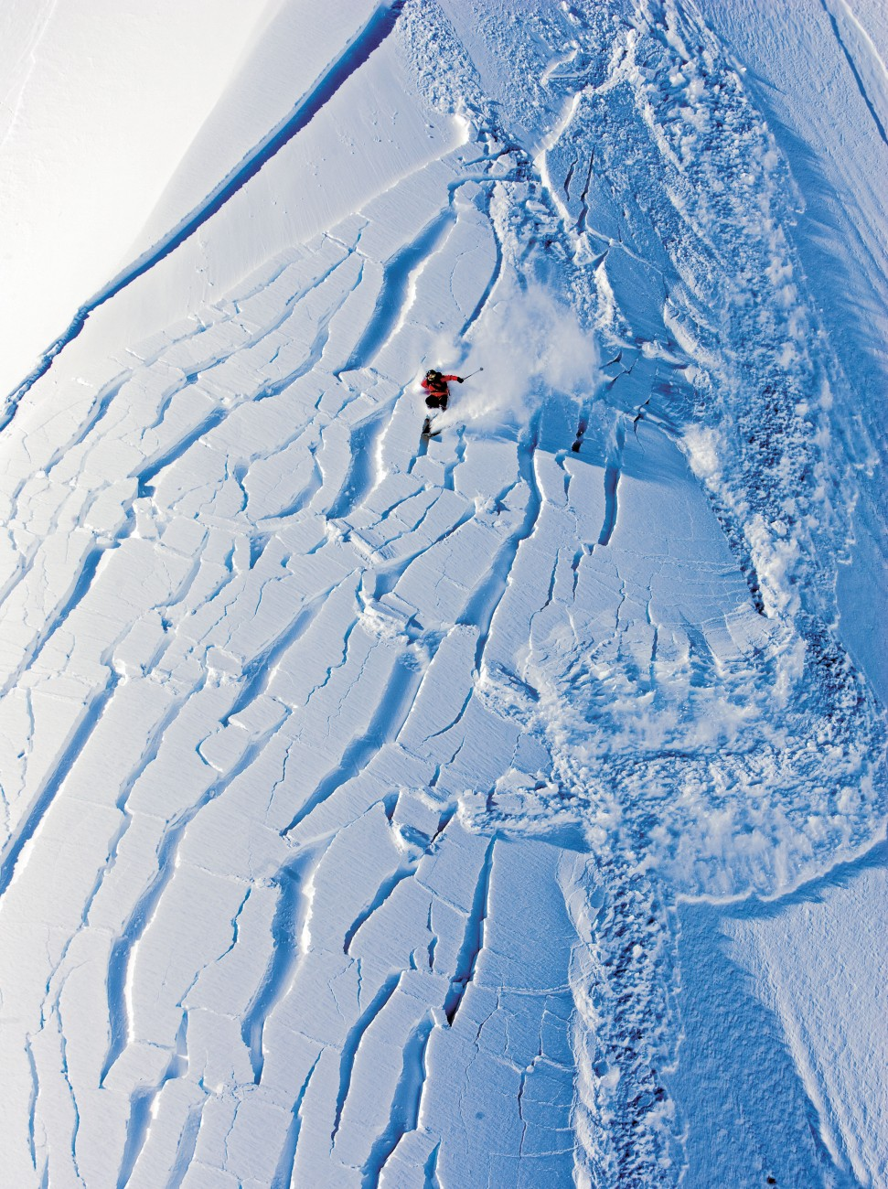 """Avalanches involving skiers are rarely caught on camera, but when extreme skier Andrea Binning carved down a face of fresh snow above Knight Inlet in British Columbia, Canada, she was being followed by a helicopter full of filmmakers and photographers recording the run for a video. A metre and a half of powder snow had fallen in one week, and the slope was unstable. """"The face that originally looked like powder heaven turned into jigsaw pieces,"""" she says. """"I tried to ski out of the slide, but the force was too great. The avalanche took me and I started cartwheeling at high speed down the face. Surprisingly, I relaxed and just tried to go with it—I think I had accepted my fate."""" Binning came to a halt at the bottom of the hill with little more than a torn knee ligament."""