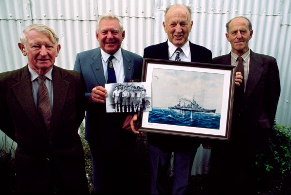These four men (Ian Feary, Bob Papps,. Eddie Peacock and Watty Bird) knew each other as children, joined the army together in 1939 On photo they are hoIding). sen'ed on the cruiser Gambia when it fired the last shots of World War 2 (other photo) and are still Friends today.