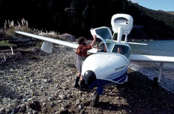 Reg Rusk, keeps a holiday house at d'Urville but lives in Palmerston North. An amphibious aircraft brings him right on to the beach outside his property at Cherry Bay.