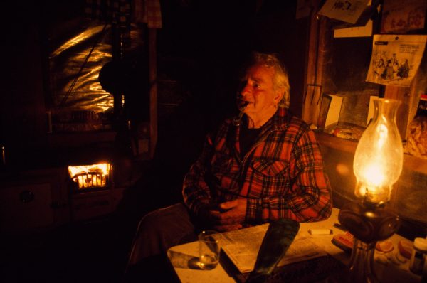 Ted Buchanan reflects on 43 years of fishing the Cascade River. One of the originators of the Cascade Whitebait Company, along with his brother Bruce, Ted has retired now, but still returns from Nelson each year to the peace and solitude of the Cascade. The rest of the camp runs on generated power, with electric lights and microwave ovens, but Ted prefers a kero lantern and coal range to those mod cons. Ted's mere was carved from a piece of greenstone he discovered near the campsite.