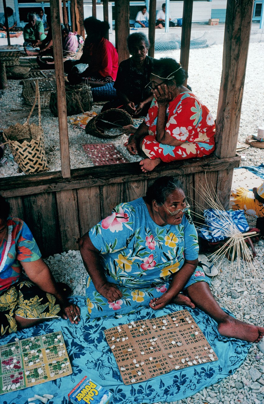 There is no shortage of counters in an Atafu bingo game, where concentration is tested by the large number of cards each woman runs. The meagre prizes-a couple of rolls of toilet paper, a box of soap powder, some prepared pandanus fibre for weaving-are clear indications of the islands' wealth.