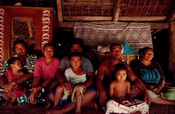 The high chief of Apolima, Natapu Siaosi, at home with family and neighbours.
