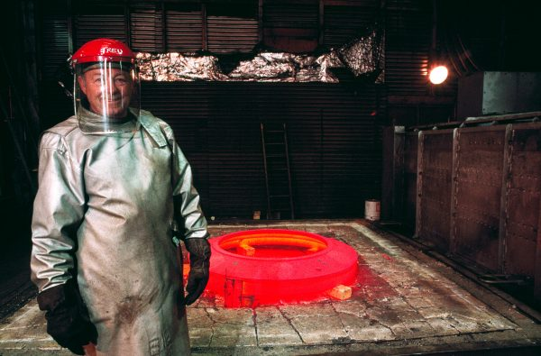 Trevor Finan removes a freshly annealed steel ring from an oven. Depending on the heating rate, final temperature and speed of cooling, such treatment can either harden or soften steel.