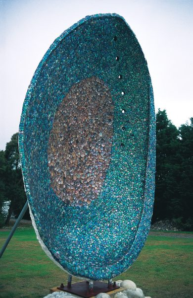 Few shells can equal the rich iridescence of the interior of the paua, a beauty that the town of Riverton, in Southland, has attempted to take to itself, first with a three-metre-high concrete and lately with an even more arresting four-metre specimen.