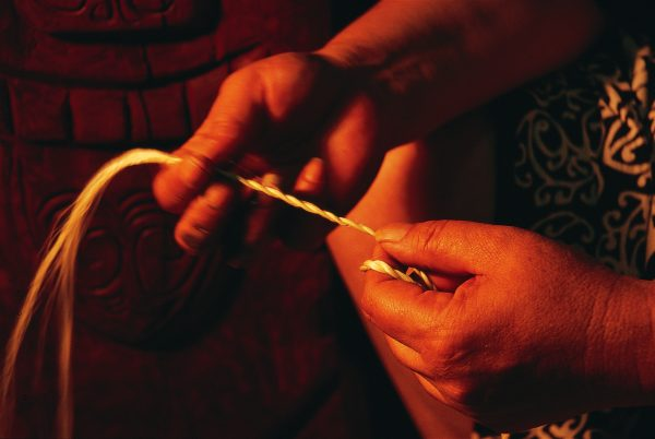 When making a cord, muka from a strip of flax is divided into two strands which are rolled down the upper leg towards the knee, imparting some twist to each separate strand; then the two strands are twisted together as the hand is drawn back up the thigh. Deft fingers and a lot of practice are required to perfect the technique, called miro or twining.