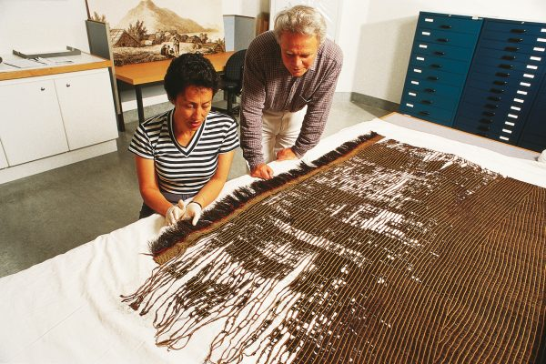 Preserving the woven treasures of the past is a problem for museums. Although undyed flax fibre is relatively stable, muka dyed dark by paru (an iron-containing mud) disintegrates rapidly. Conservator Rangi Te Kanawa (daughter of Diggeress) and industrial chemist Gerald Smith consider how to arrest further deterioration in a garment at Te Papa Tongarewa, the Museum of New Zealand.