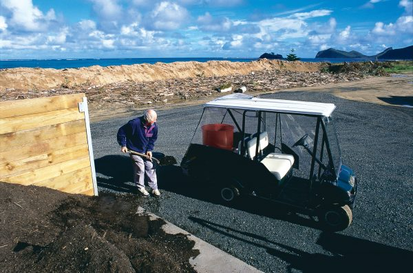 Eighty-five per cent of the island's waste is now being recycled or composted. The vehicle being loaded is an electric car, one of a handful on this environmentally aware island.