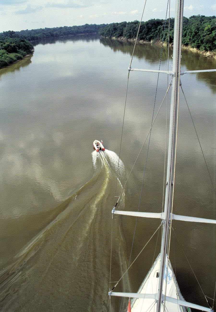 """Hardly more than a few minutes goes by without a change of course to keep in the deepest section, or avoid a sandbar, or pass an island,"" wrote Blake in his Amazon log. Even with Seamaster's shallow draft and retractable centreboards and rudder, she was at risk from what lay beneath the water's surface. A radio-linked inflatable with a portable depth sounder was often despatched to check what lay ahead. To run aground here was to face the prospect of being stuck for months waiting for the wet season."