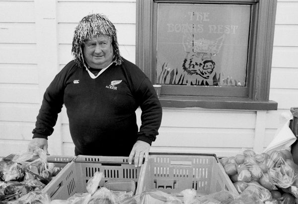 Further along Pollen Street, a produce vendor enters into the spirit of market day, selling fruit & vege's from his stall garbed in a tinsel wig.