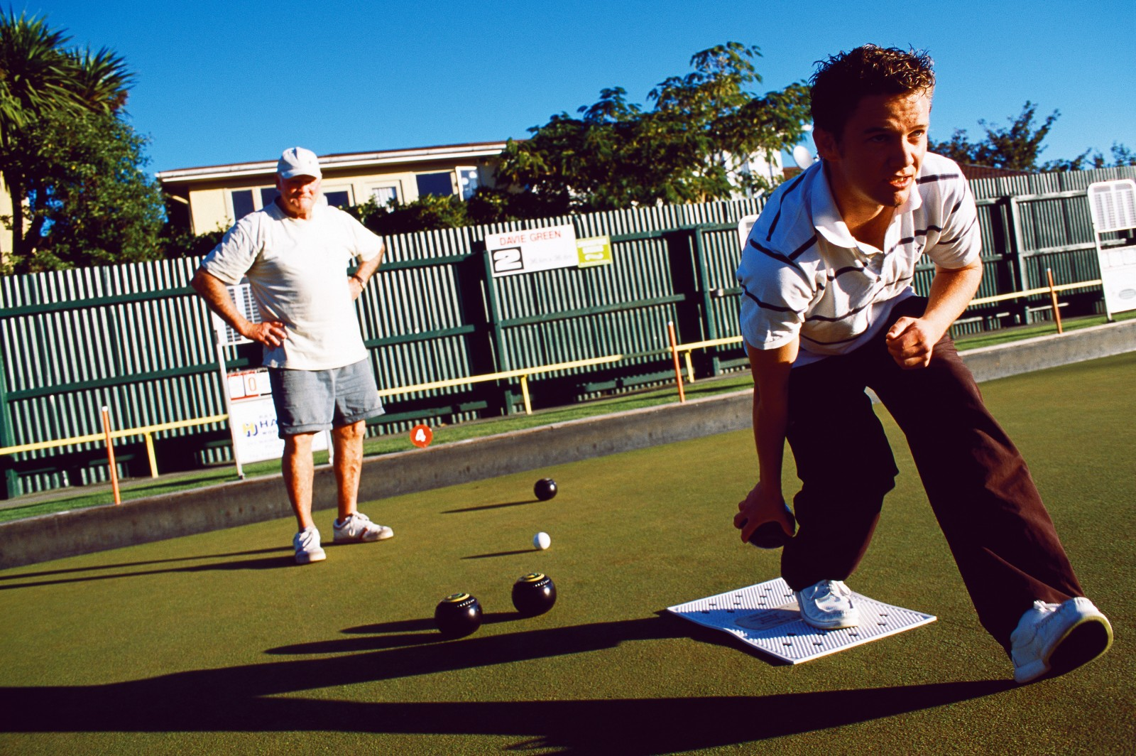 Bowler Luke Rhind from Karamea, an active proponent of the Mates in Bowls initiative, takes his turn at the Burnside Bowling Club.