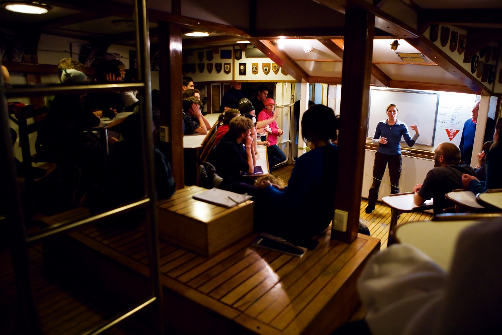 Unusually, on Voyage 530 the greater challenge lay with the ship's crew rather than the trainees. As the storm raged for 30 hours, crew not only had the ship's safety to think of but also the entertainment of the 40 trainees below decks. At such times, the Spirit's auditorium becomes a vital cog in the operation of the ship and energy is channelled towards team-building exercises, performances and navigation and safety lessons. For some, the challenge of accepting leadership in a team-building exercise or talking in front of a group of their peers can be as daunting as any physical challenges.