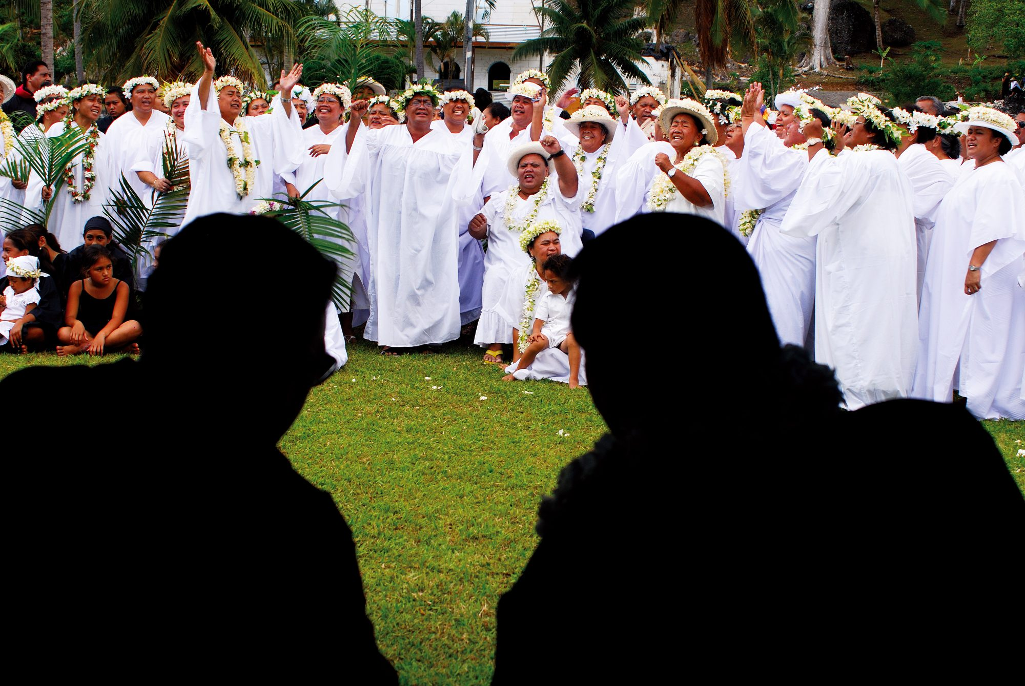 The national Gospel Day nuku, on October 26 each year, draws an assembly from each of the six parishes of the Cook Island Christian Church on Rarotonga. Gathering on the grounds of the Takamoa Theological College, they perform songs, pantomimes and biblical story re-enactments that recall the arrival of Christianity to the Cook Islands. 'Imene pure, church songs, are mostly English hymns translated to Cook Island Maori, while ' imene reo metua combine the tunes of German bar-room ballads with words drawn from the gospel. Members of the Avarua CICC congregation (left) entertain the crowds with a forceful ' imene tuki, a style of singing unique to the Cook Islands.