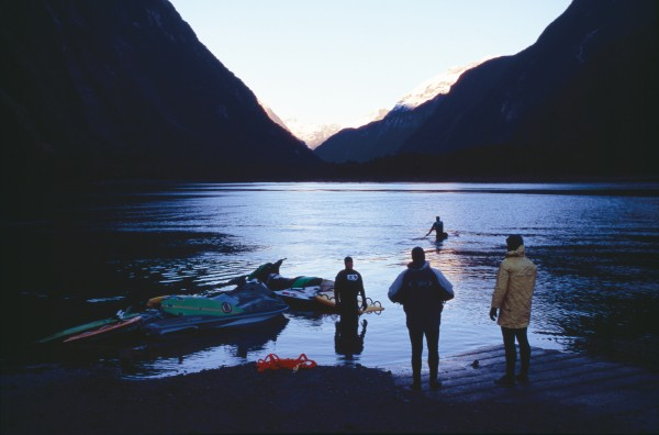 Doug Young, Miles Ratima, Kyle Davidson and Taane Tokona gather at first light in Milford Sound to set off on a Hyundai-sponsored big wave discovery mission. Touring on jet skis has opened up previously unexplored surfing territory.
