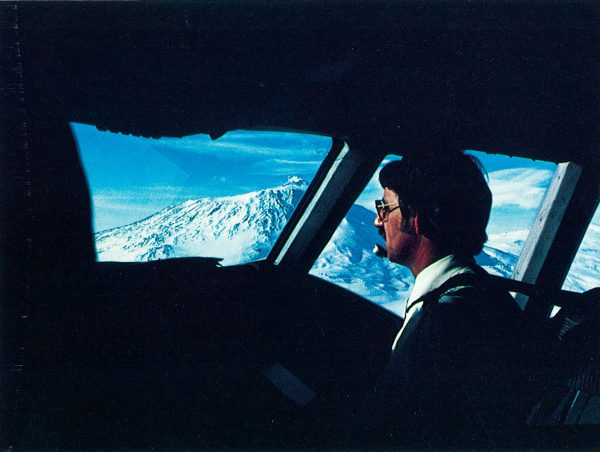 Early sightseeing flights passed close to Erebus, north of Scott Base. Pictured at the controls is Allan Mulgrew, was to lose his life on the volcano's icy slopes.