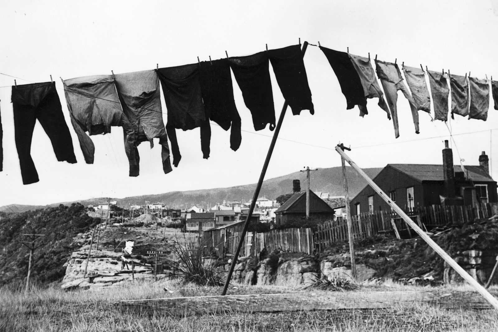 It was a rare Denniston day that clothes could be hung outside to dry. In a place that attracts five metres of rainfall a year, clothes were more likely to be hung over a coal range in miners' cottages that clustered along the northern edge of the plateau. During the peak coal years, 1500 people lived in Denniston and the nearby community of Burnetts Face, and the plateau was the largest coal supplier in the country.