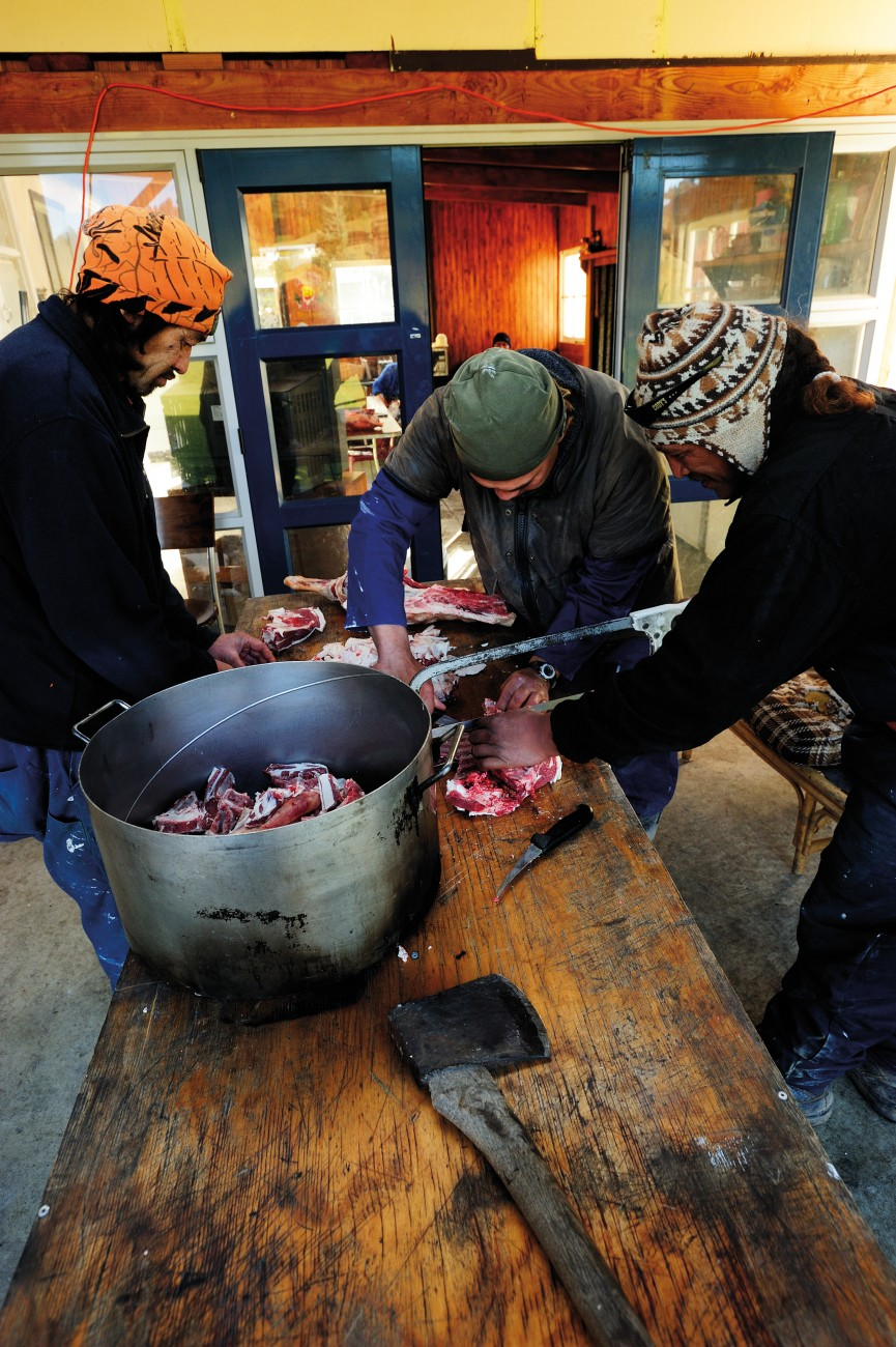 "Axes, hacksaws and boning knives are brought to the task of butchering meat for the traditional boil-up—a soup featuring meat bones, puha and potatoes, the mainstay of marae meals. Many returnees from the city find a comfortable role working 'out the back' of the marae, while their cousins with a better grasp of language and protocol take a more visible stance at the front. One role is not seen as more important than the other. A proverb says, ""Ko te amorangi ki mua, ko te hapai o ki muri""—without the back, the front won't function."