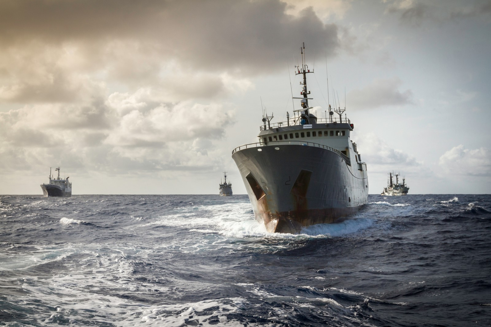 The incident only stiffened the campaign's resolve, and as international attention mounted, added to their number, right. The Australian toothfish long-liner Atlas (far-left in picture) joined the two Sea Shepherd vessels in the pursuit off West Africa. The Atlas was signalling symbolic support from COLTO, the Perth-based Coalition of Legal Toothfish Operators, which had previously been critical of the Sea Shepherd campaign.