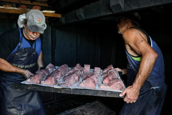 Gamefishing season is a busy time for Kaeo butchers Dave and Doug Holland, here loading the smokehouse with marlin steaks.