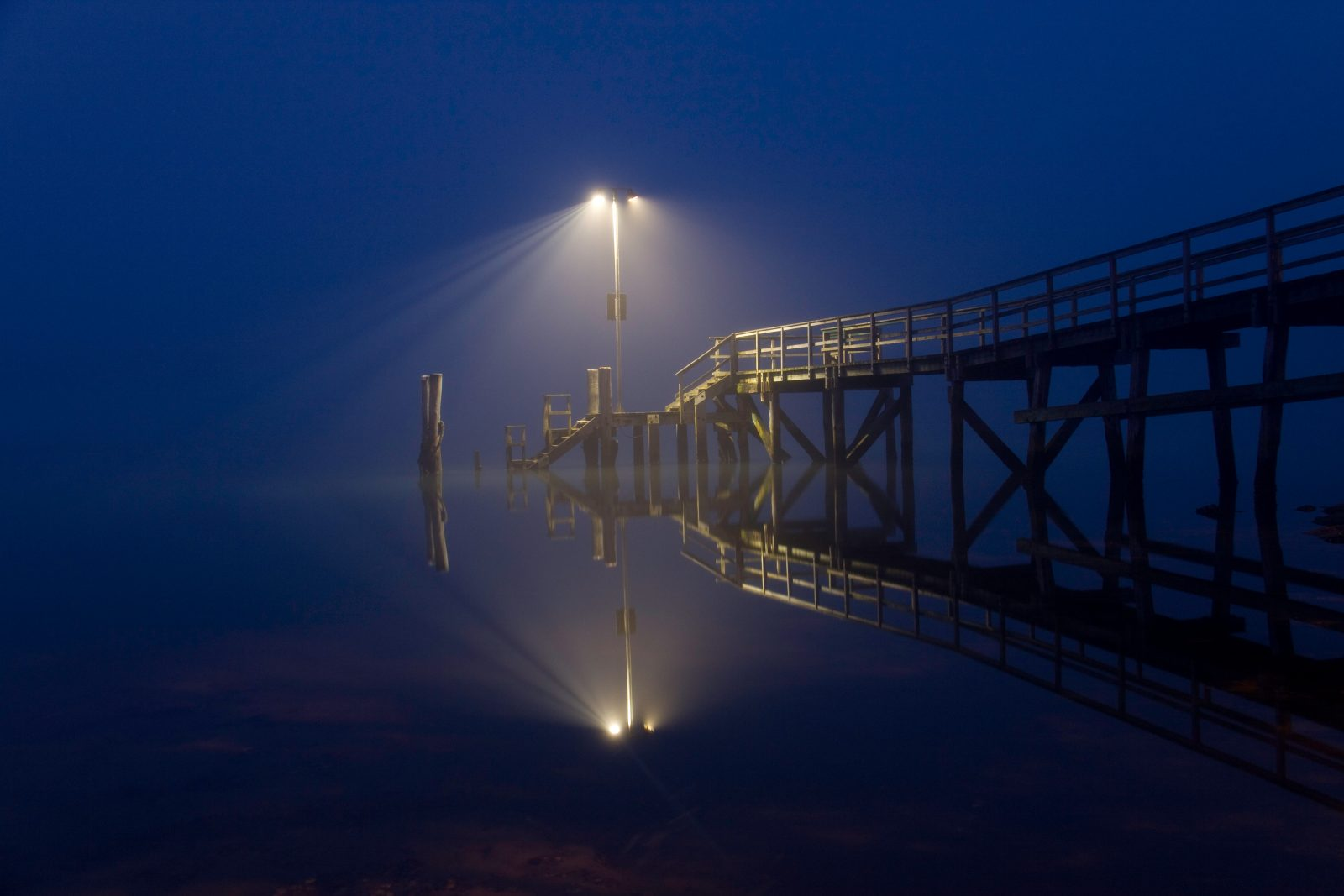 A shot of the Beach Haven wharf, at Larkin's Landing, taken just before dawn in September. With no wind the water is like glass and the thick fog provides a lovely ambience.